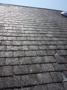 Reclaimed slate may possibly be an option to keep costs down, and is sometimes preferable as it will blend in better with an older roof.